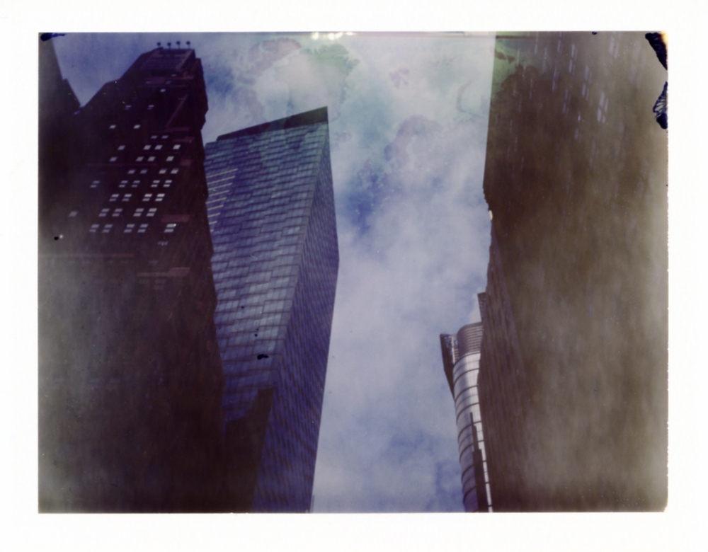 Double exposure. map and buildings, times sq