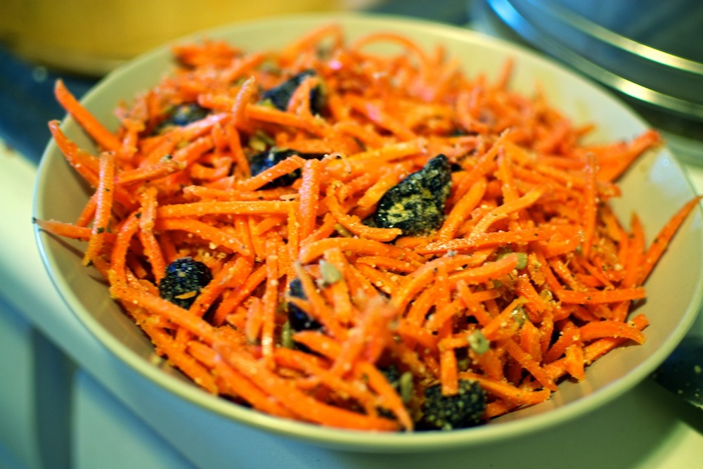 Carrot, prune, garlic and sunflower seeds salad