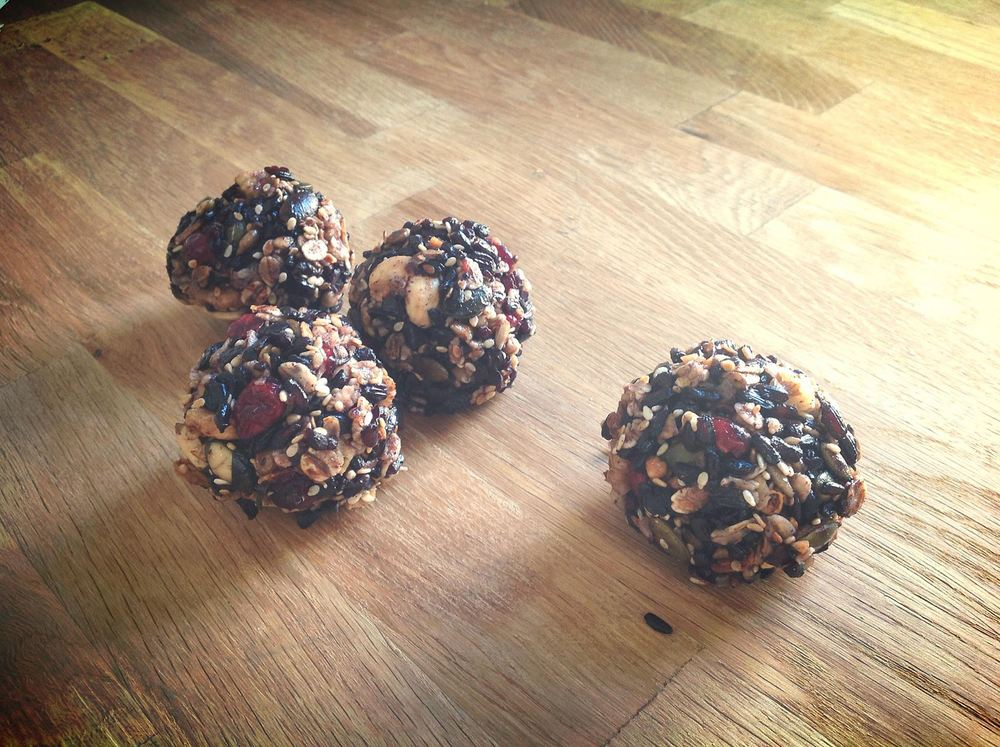Handmade granola treats with black rice, nuts, seeds and honey