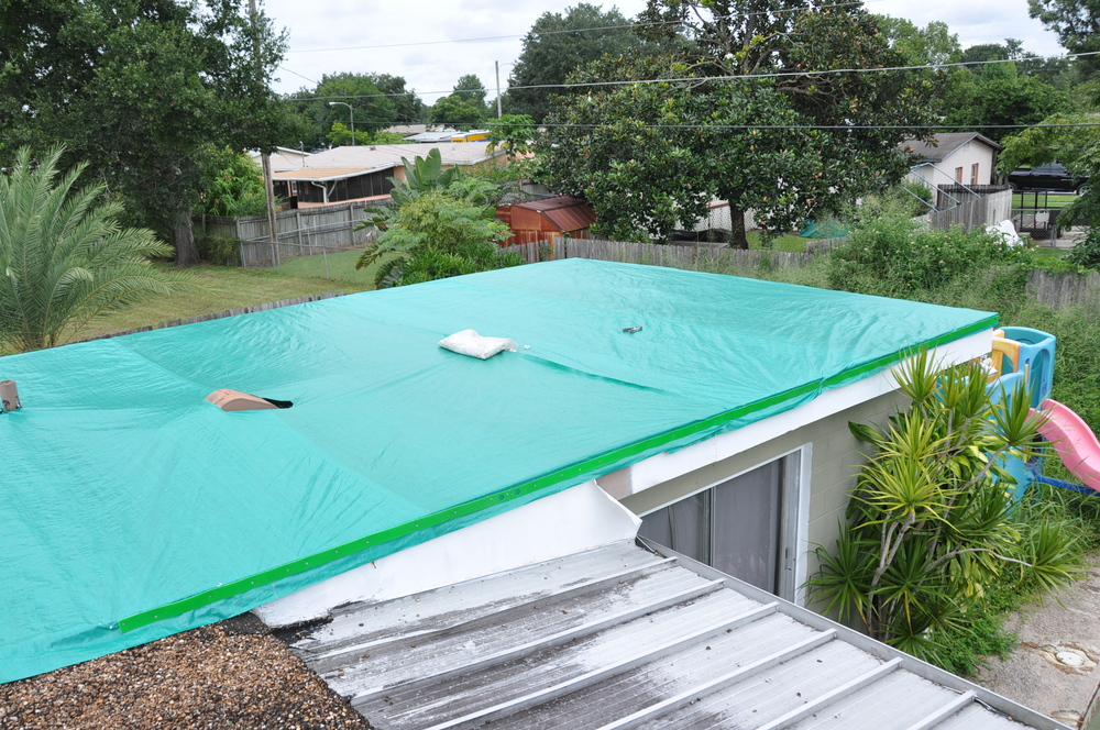 Fix Leaking Roof How to install a roof tarp on a gravel roof. — Temporary ...