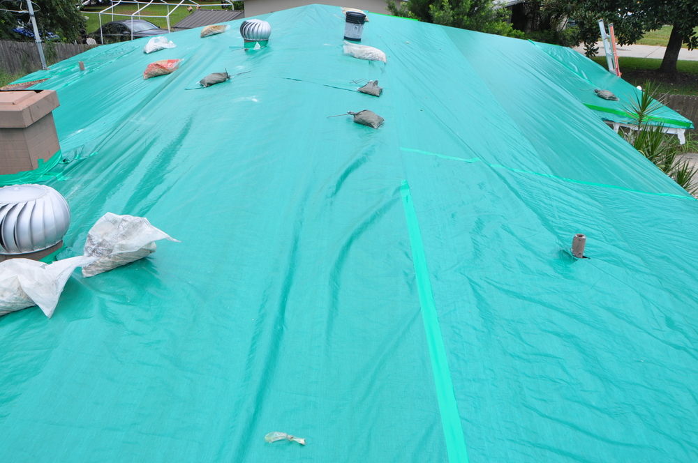 How To Install A Roof Tarp On A Gravel Roof Orlando