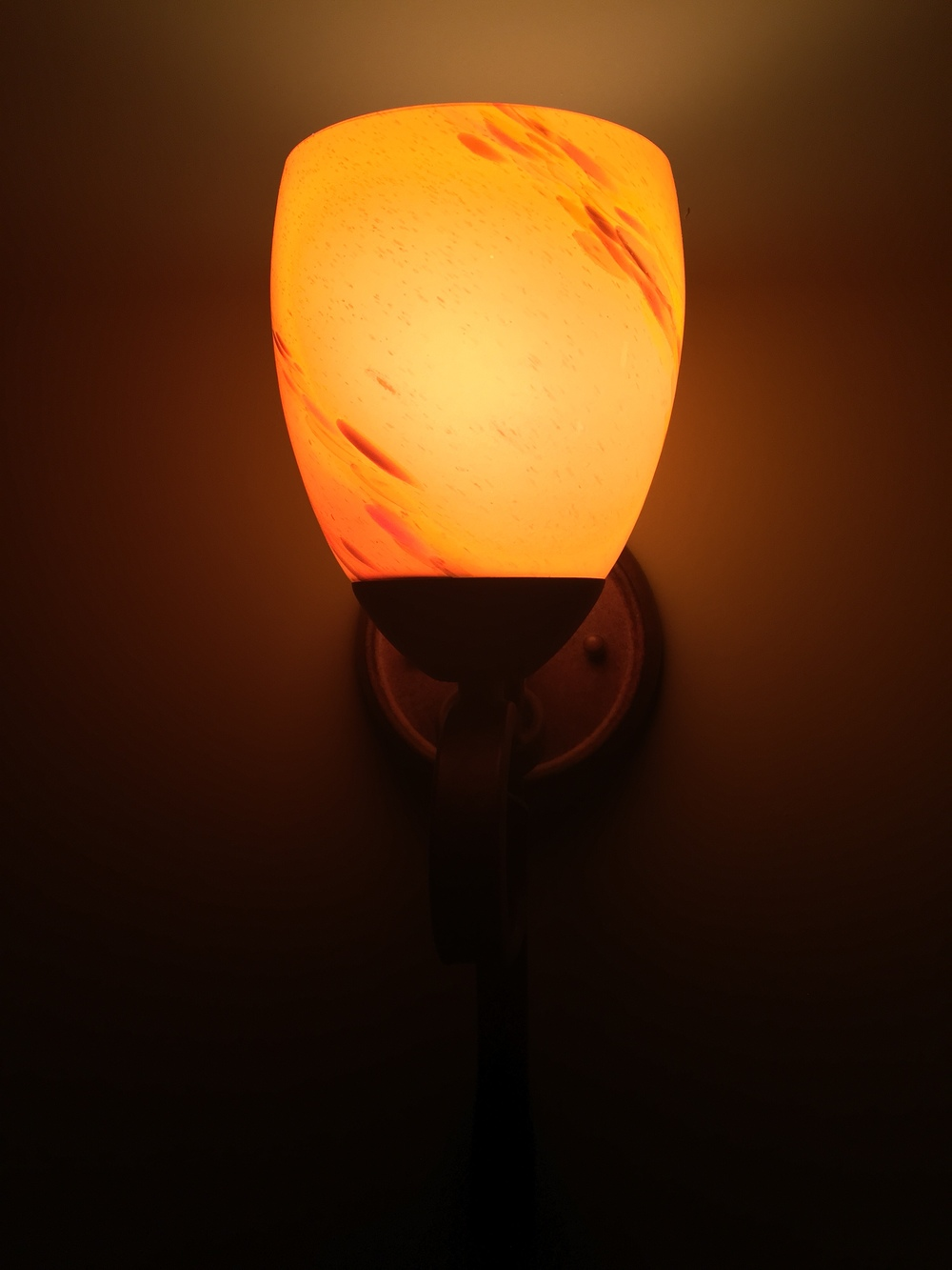 did you really think i was going to include a picture of my shower?  this is a sconce in my bedroom.  i love the way it glows.