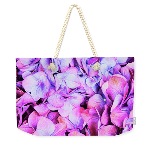 Chic and perfect for all their stuff - Weekender tote bags are large enough to tote the world. Grab one here!