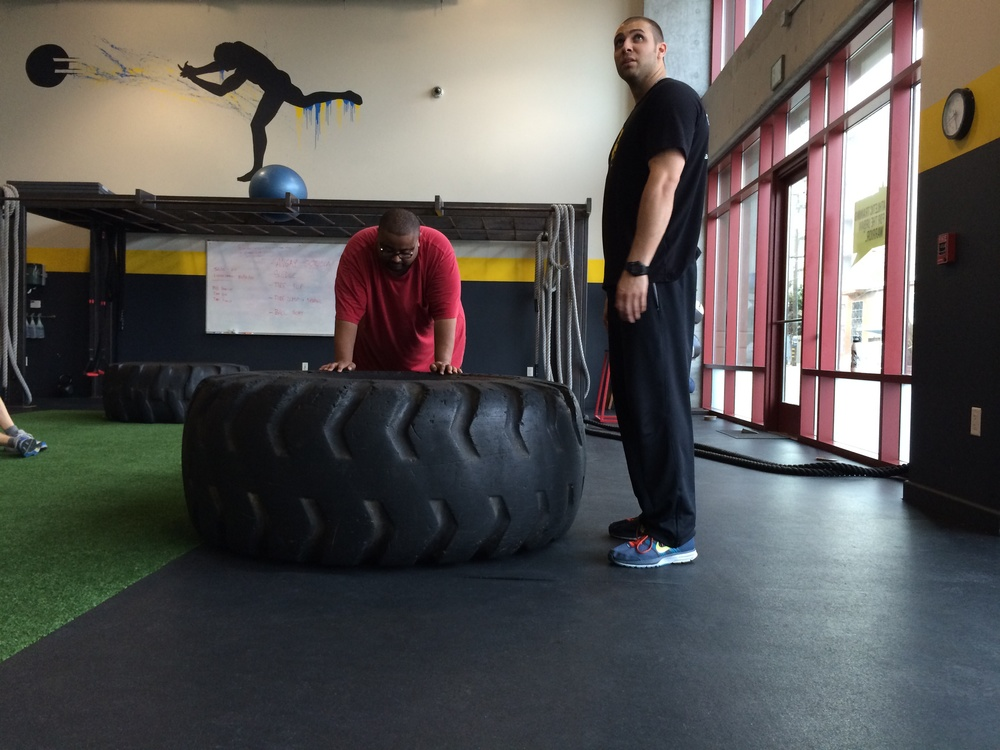 Urban Fitness owner Noah Kinner works with Marcus Johnson
