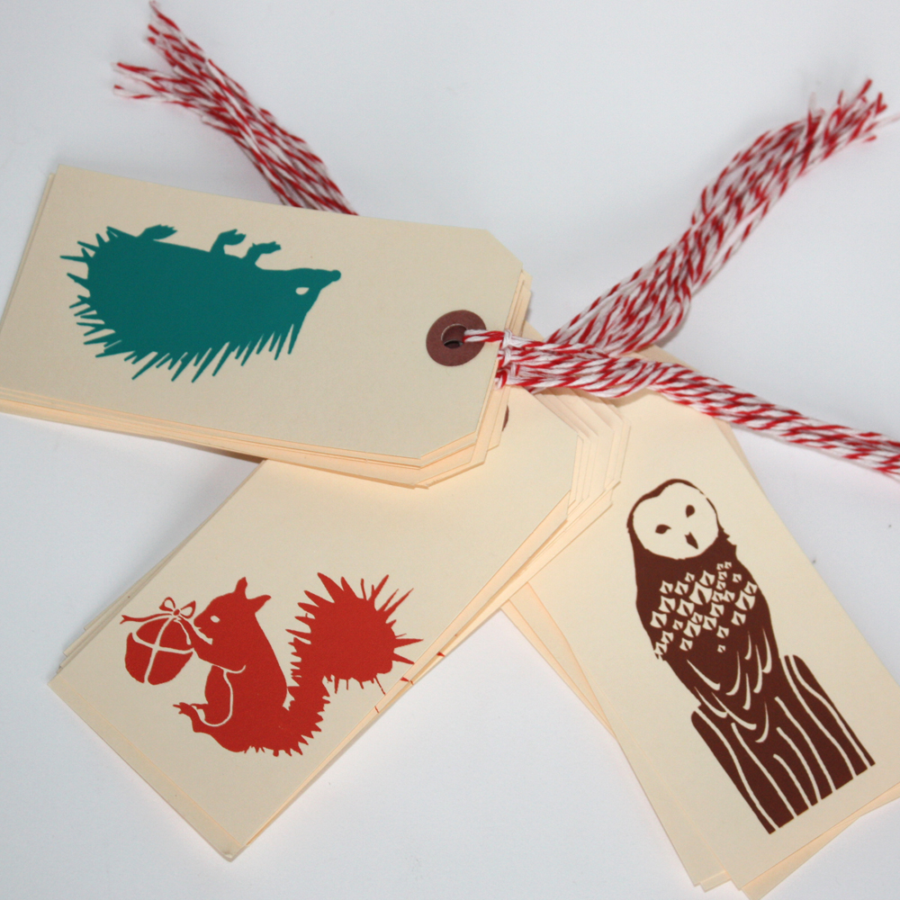 This morning's task was to make new gift tags for the Fall. I decided some rusty, young squirrels, toffee brown owls and emerald green hedgehogs would be just the ticket. These sell in the shop for $1.50 or any 6 for $7.50 and go great with any gift. I like to tie them around the neck of a wine bottle and write my Thank you note on the back!