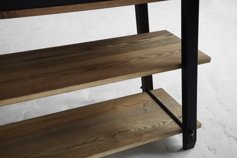 The rich patina is achieved by oxidizing the wood's natural tannins with vinegar and iron. This centuries-old technique turns the walnut a deep ebony and brings out shades of amber, gold & green from the white ash, which vary from board to board.