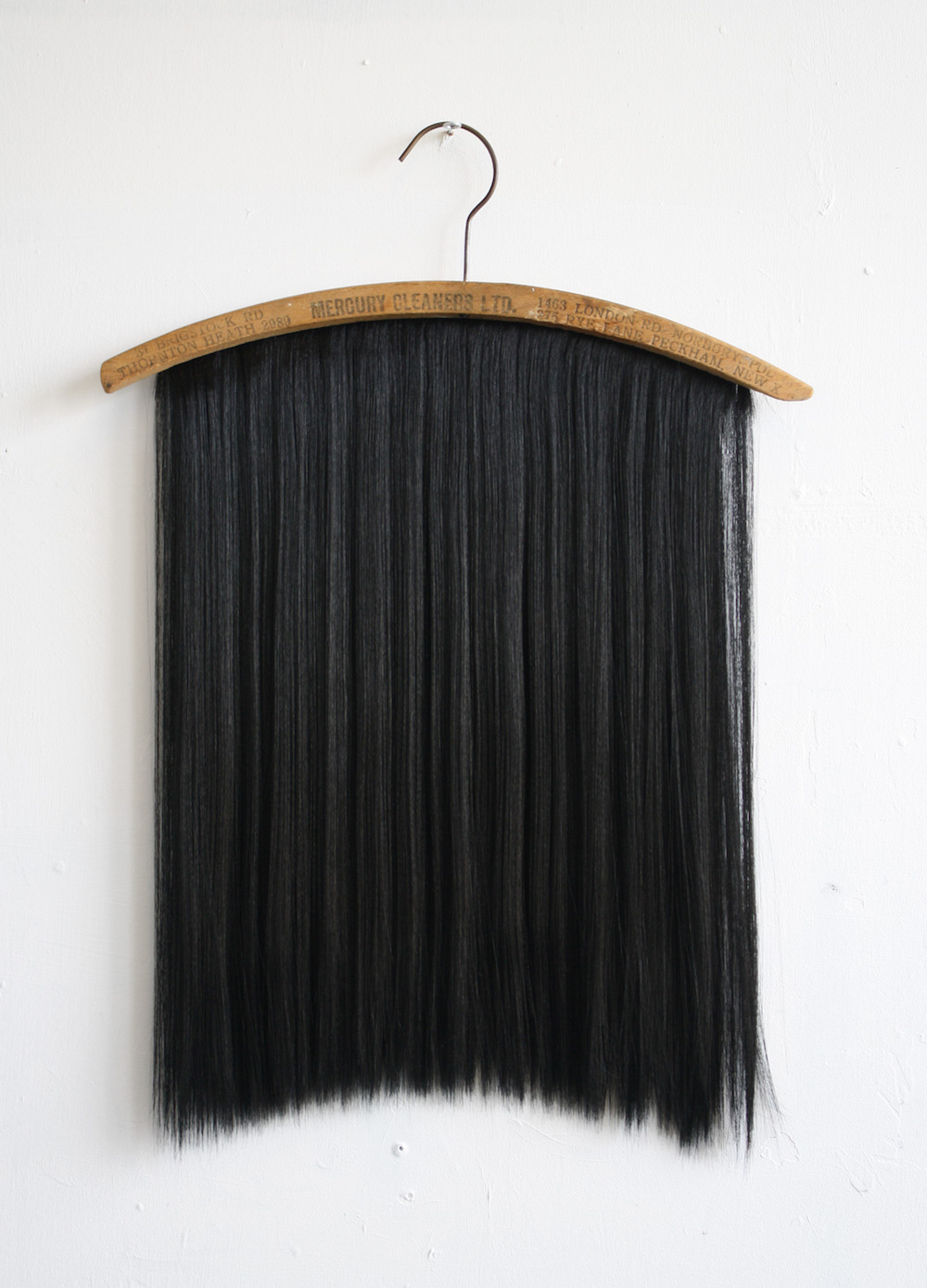 Chaetophobia (Mercury Cleaners LTD Peckham) 43 x 58 cm Found wooden hanger and synthetic hair 2015