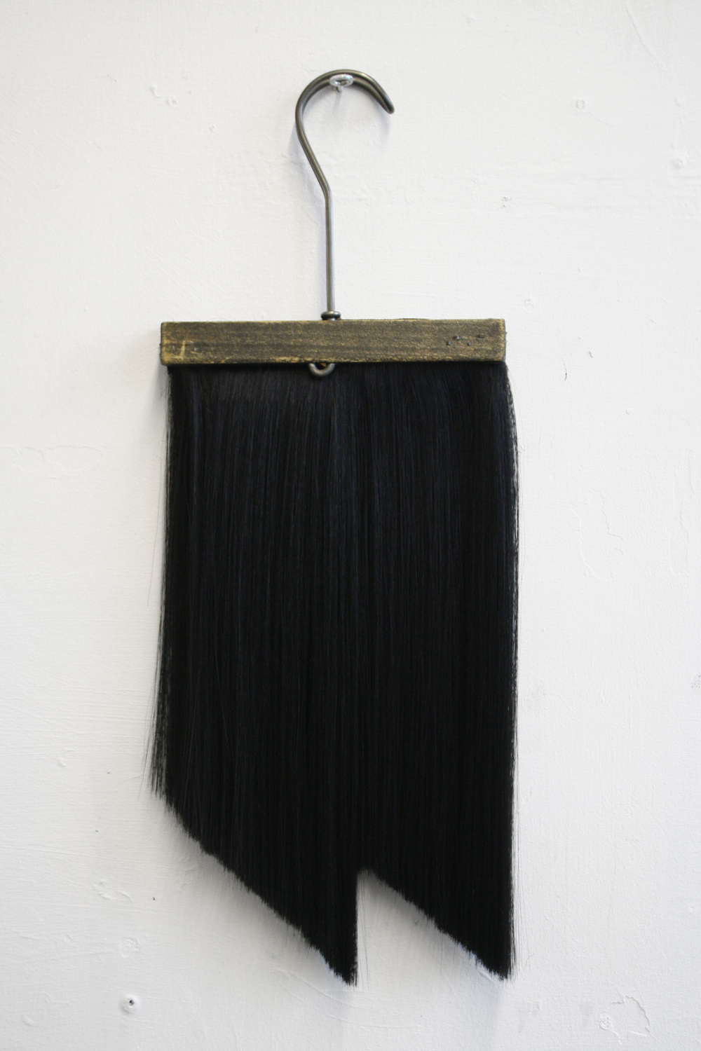 Chaetophobia (Trouser Hanger)  15 x 40 cm wooden hanger and synthetic hair 2015