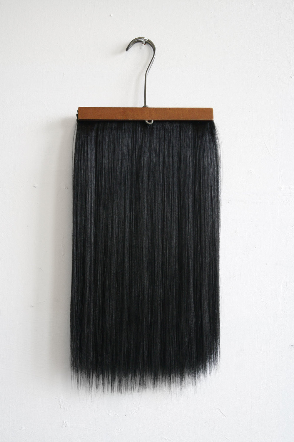 Chaetophobia (Trouser Hanger 2) 20 x 53 cm  Wooden hanger and synthetic hair 2015