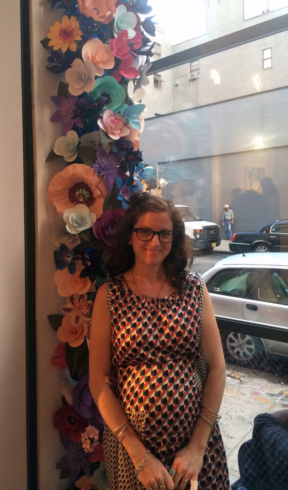 Flowering—A Group Show     RISD MFA 2014 Painting show     Pictured above is Eloise Danch and her paper floral creation for the Flowering Show. Eloise installed hand made paper flowers on either side of the main window that looks out of the gallery. Hundreds of handmade flowers frame the window and set a beautiful tone for the show. The flowers look other worldly and are impeccably created. Worth checking out just to see these beautiful summer flowers!        nancymargolisgallery.com