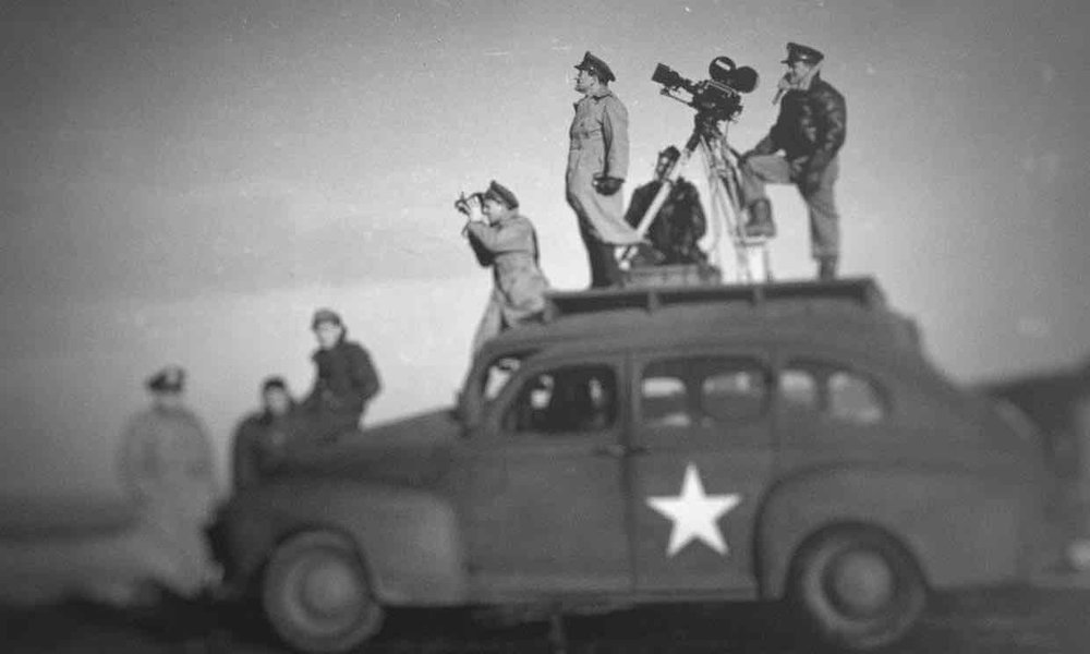 John Ford shooting a US Army propaganda film. Photograph: Netflix