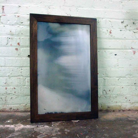 Custom hand-silvered mirror in rusted handmade frame