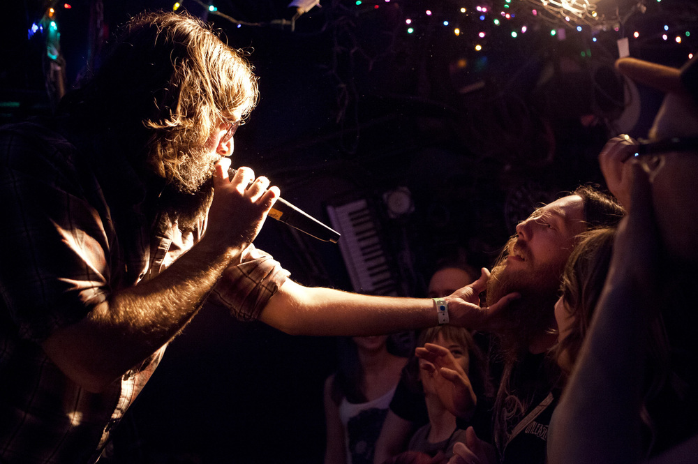 Lead singer of The Beards Jonathan Beardraven touches a fan's beard as the band preforms a song about beards.​