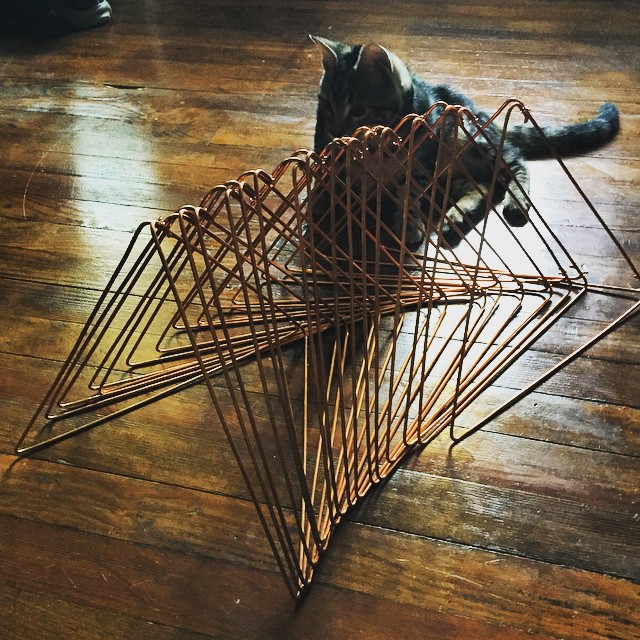 Endless armies of bent metal forms to amuse the cat… I mean, for the wedding business. @leavesofgrassdesigns