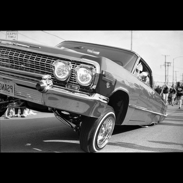slow and low  #lowrider #chicagolowriders #laraza #chicano #arte #blackandwhitephoto #trix400 #leadinglines