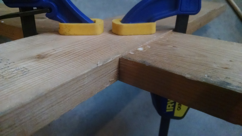 Side view of the half-lap joint all glued up and clamped down