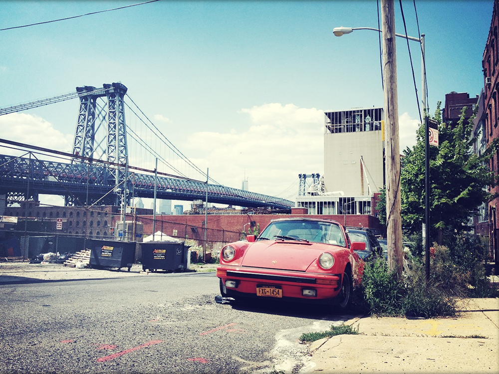 I ran into this rough  G-series 911  in Brooklyn, NY last summer. Since I'm a sucker for New York City in general and Porsches in particular, I had to make a quick stop next to this old red warrior. Worn interior, sad 'eyes' but as an innocent observer I just loved the style of the car.