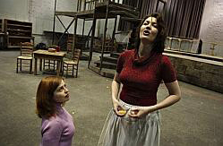 Opera singer Viktoria Vizin (right), with assistantdirector Leslie Halla, rehearses for the Lyric Opera ofChicago's upcoming production of 'Carmen.' Vizin, aresident of Aurora's far East Side, will perform thelead role.