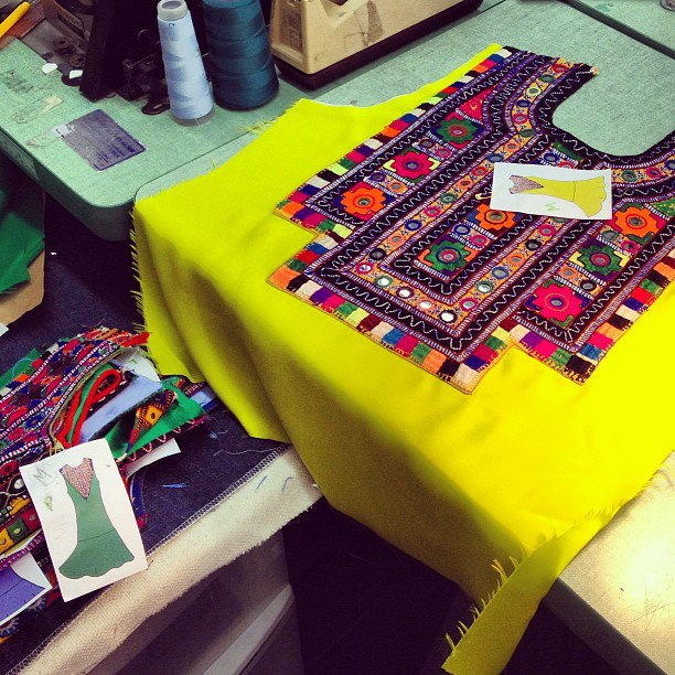 each embroidery for the  drop-waist shift dres s has a different design and shape, and has to be finished by hand