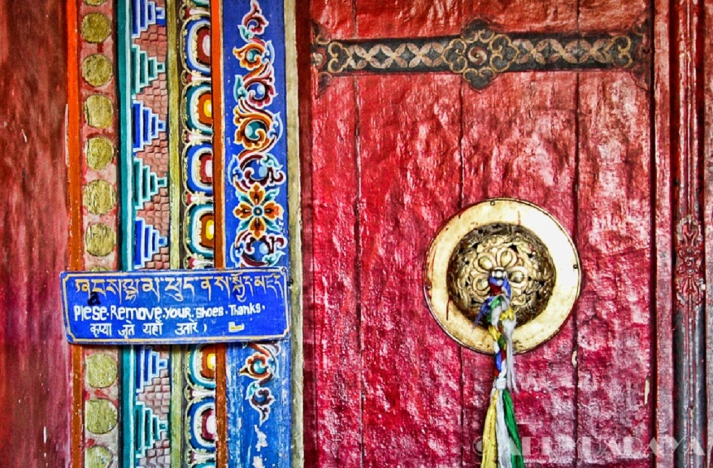 my-spirits-aroma-or :     An artistic door of a buddhist monastery in Ladakh, India with the customary notice to leave your shoes outside   by Abhy Shrivastava