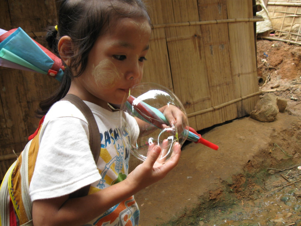 Snap this shot of a young girl blowing bubbles. Kids at the camp can find fun in almost everything.