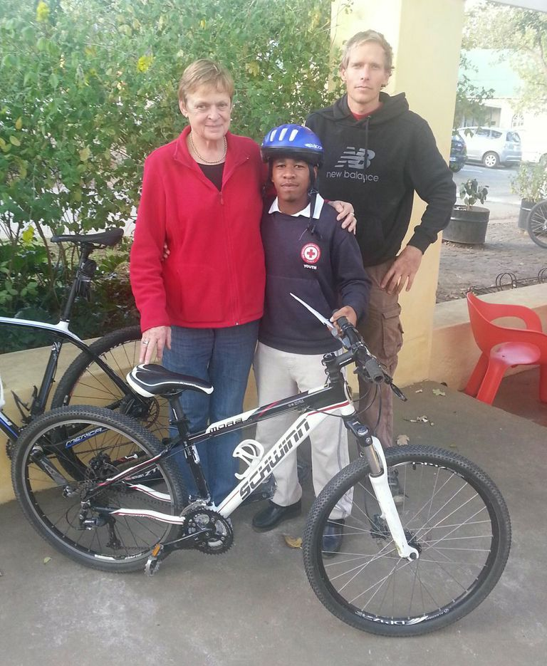 Marchel Abrahams takes charge of the Red Cross bike sponsored by Jenni Martin.