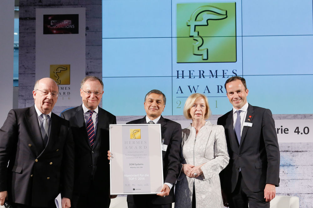 From Left to Right, Prof. Dr. Wolfgang Wahlster, Head of the HERMES award Jury, Chairman of the Board of the German Research Center for Artificial Intelligence, Stephan Weil, Minister President of Lower Saxony (Niedersächsischer Ministerpräsident), Dr. Suman Das, Prof. Dr. Johanna Wanka, German Federal Minister for Education and Research, and Dr. Jochen Köckler, Member of the Managing Board of Deutsche Messe, Hannover, Germany