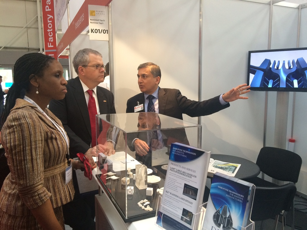 US Deputty Secretary of Commerce Bruce H. Andrews visits with Dr. Suman Das in DDM Systems' booth at the 2016 Hannover Messe on April 26, 2016