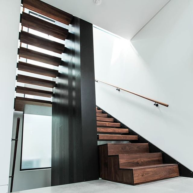 Blackened steel and walnut residential stair. Central internally-lit monolith from basement to 2nd floor with stair wrapping around... #blackenedsteel #steelstair #stairporn #monolith #customfabrication