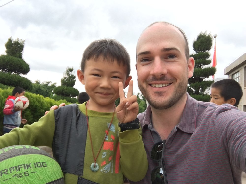 With new buddy Yihao in Tangjia, rural Yunnan