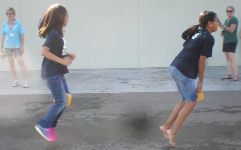 Girls hop in water game June 2015.jpg