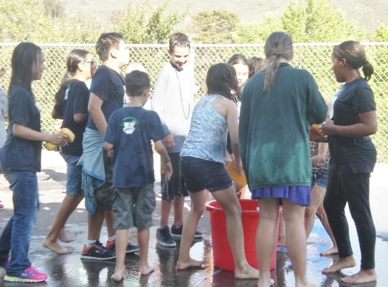 Kids gather round to soak someone June 2015.jpg