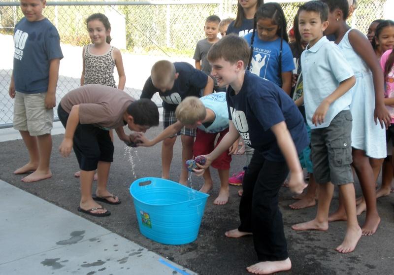 Kids soak sponges ready to get 5th graders June 2015.jpg