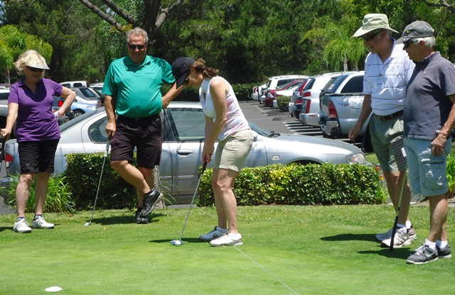 Angie shows off putting skills Benefit 2014.jpg