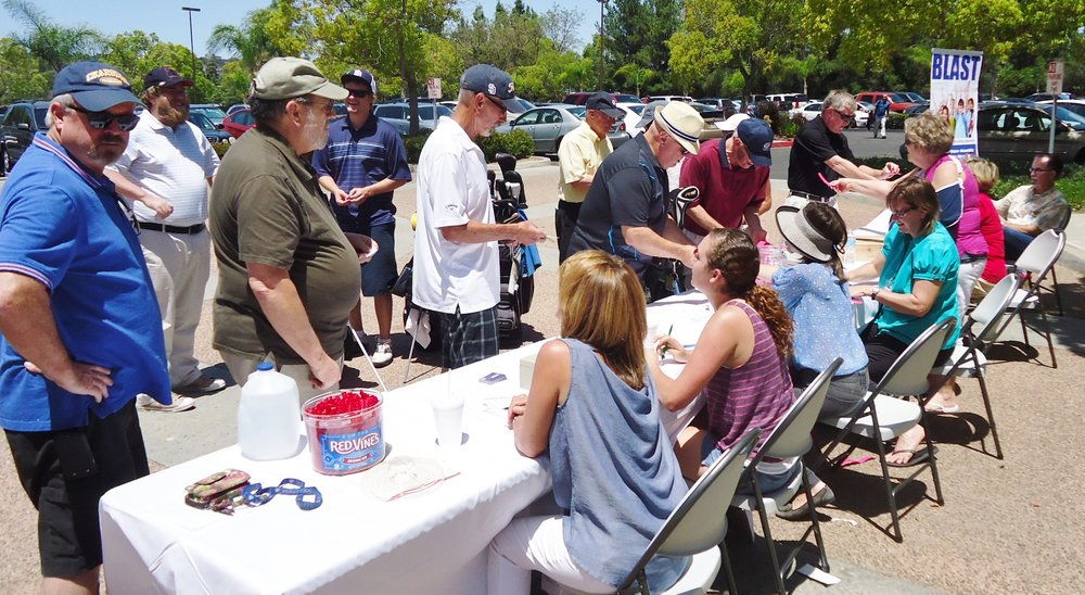 Golfer Signm in May Benefit Vineyards.jpg
