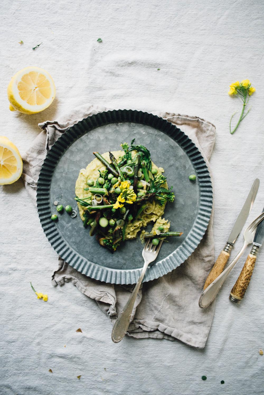 asparagus, pea + broccoli rabe saute over a chickpea + chive mash