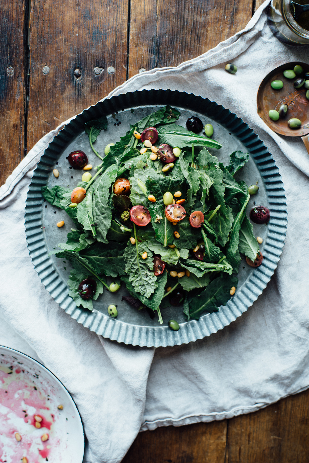 warm sauteed grapes, autumn kale + edamame salad