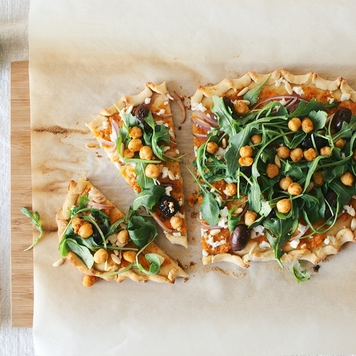 romesco pizza w/ spiced chickpea + arugula