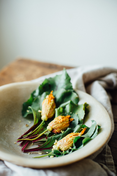 baked squash blossoms stuffed w/ beet hummus