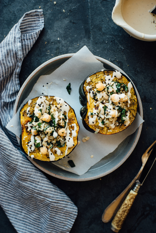 stuffed za'atar roasted acorn squash w/ pepper-lemon tahini sauce