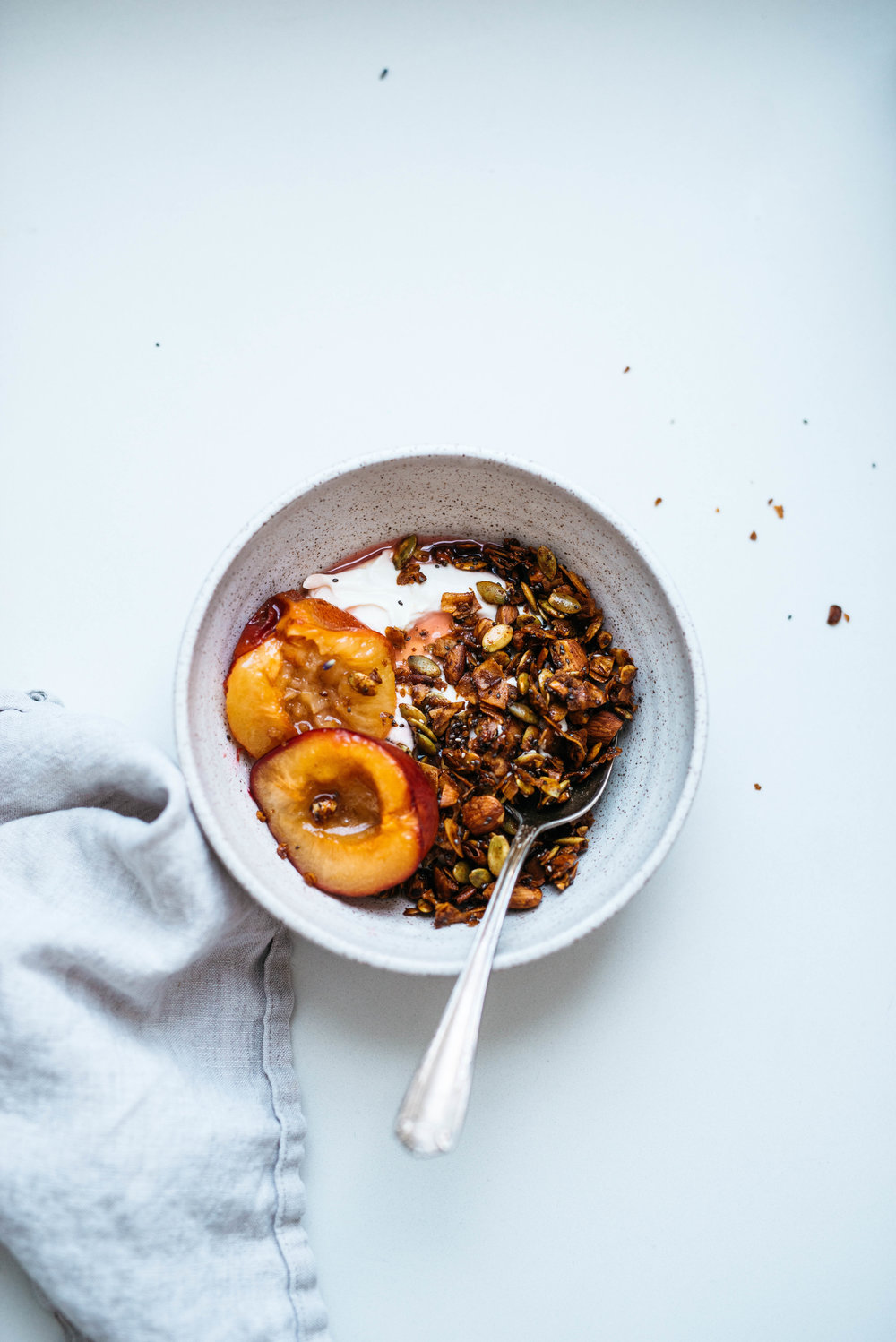 Pepita-Coconut Granola w/ Maple Roasted Plums | Dolly and Oatmeal