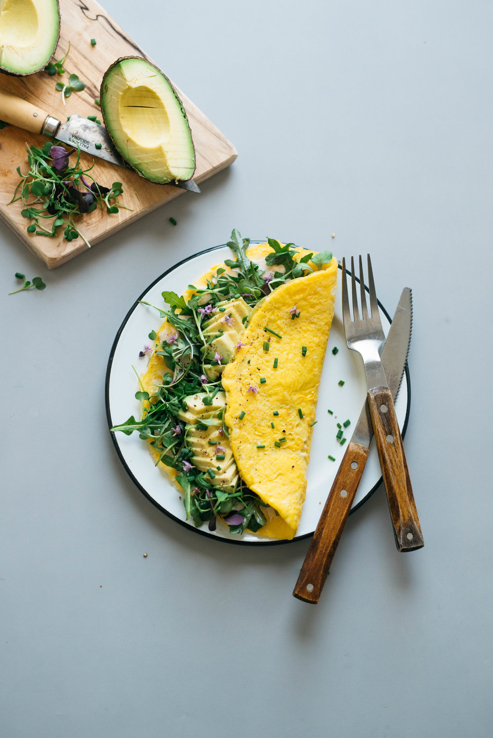"""NUMBER 6:  BREAKFAST FOR DINNER: """"CREAM CHEESE"""" OMELETTES W/ BALSAMIC GREENS   breakfast for dinner is a staple in my house, and i was so happy to learn that it's a favorite of yours as well! such a simple little recipe of refrigerator and pantry components that come together offering a good amount of protein, healthy fats, and fiber 💪🏼leaving your belly full and happy!"""