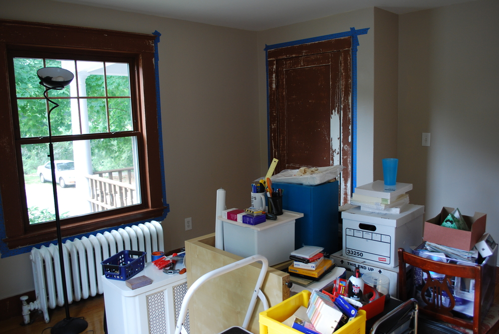 A work in progress.  The walls have been painted, now it was time to sand down the doors and trim.
