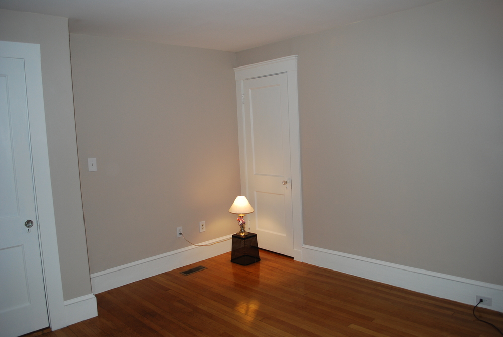A big difference!  The white doors, trim and decorative rail for the baseboards really updated this room instantly.