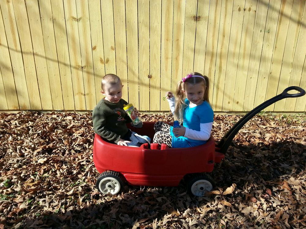 Playing in the backyard: Ezra loves the sound of the wagon crunching the leaves underneath! Grace loves blowing bubbles for her baby brother! ..note her very unique sense of style!