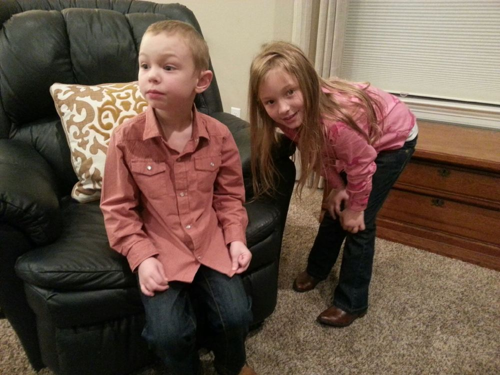 "It was ""Western Day"" at school last week. Ezra was not too sure about his pearl snap shirt, boots, or the camera! Grace tried to cheer him up!"