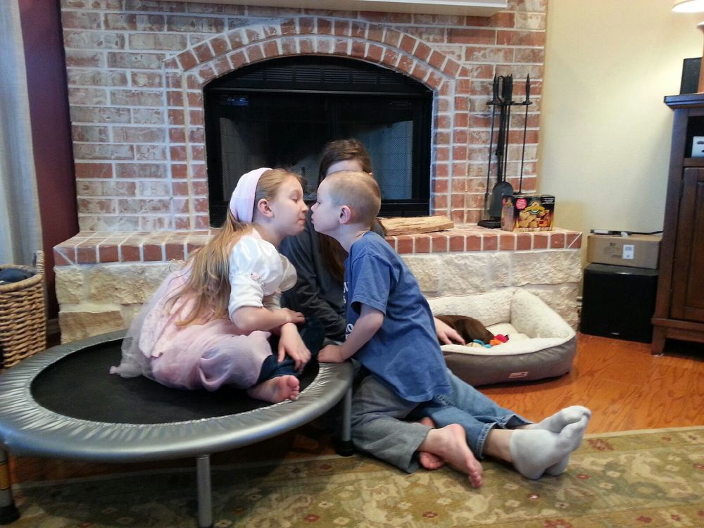 Ezra gave Grace kisses. She was so excited! He has allowed her to kiss him before, but this time he was the one looking for kisses!