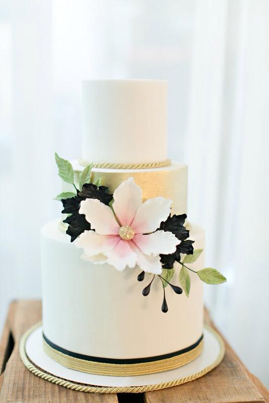 "Lydia Photography....""Fondant cake with gold middle tier.. sugar flower, leaves, and berries"""