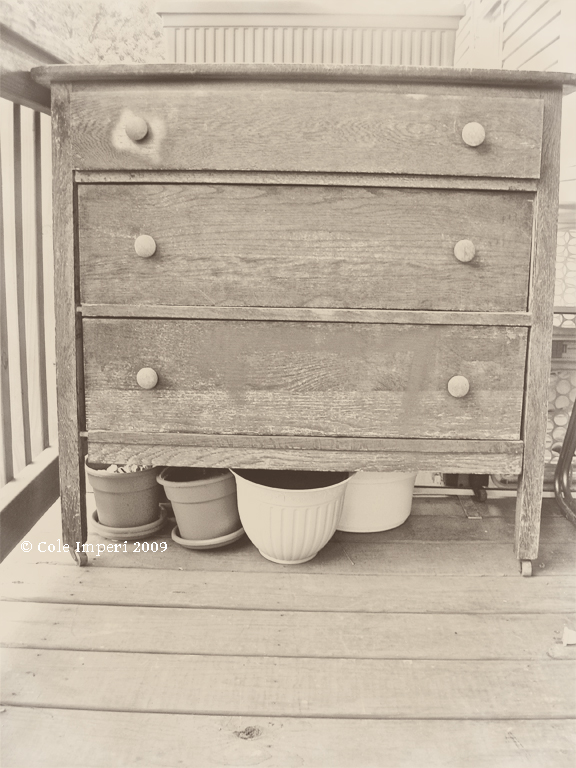 This is an old dresser that's found new life as an outdoor garden storage unit.