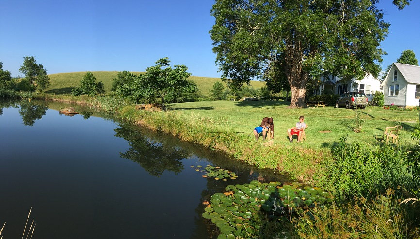 Fish pond at farm with grandsons fishing